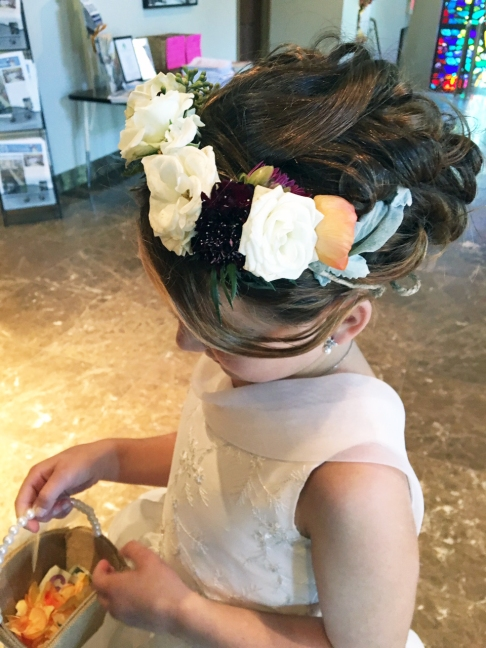 flower girl wearing flower crown