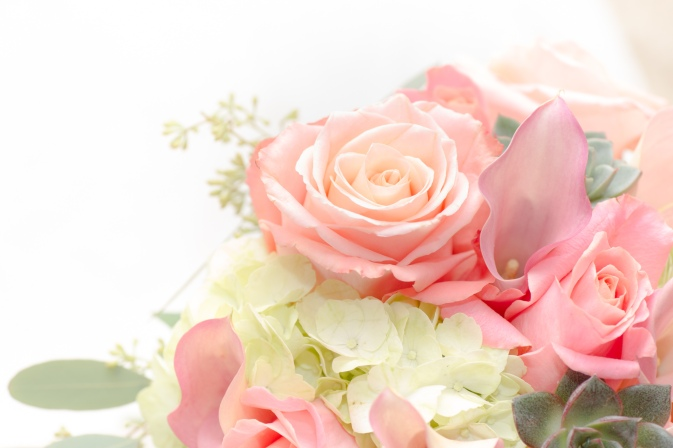 Bridal bouquet with garden roses, pink mini calla lillies, white hydrangea and succulents