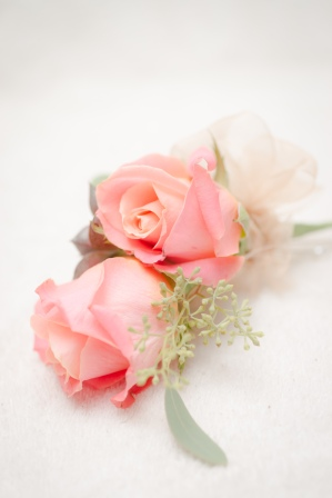 pink rose with seeded eucalyptus boutineer