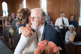 bride hugging father at Spray Beach Chapel