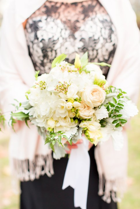 bridesmaid bouquet with white garden roses, wax flowre, freesia, and lisianthus