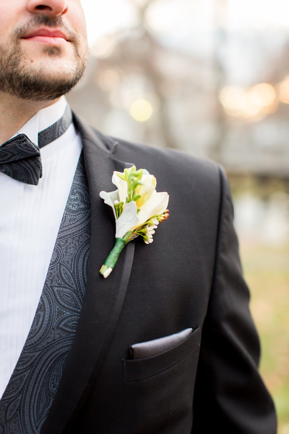 boutonnieres with freesia and wax flower